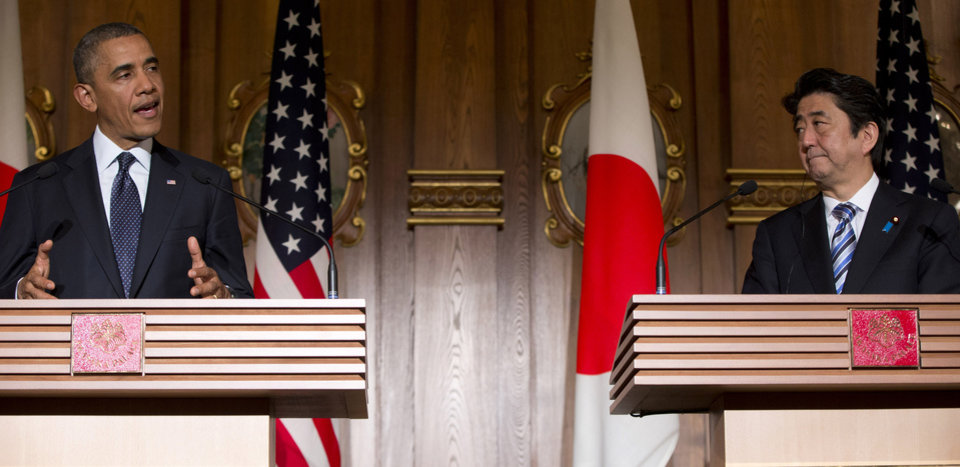 Photo - President Barack Obama, left, and Japanese Prime Minister Shinzo Abe participate in a joint news conference at the Akasaka State Guest House in Tokyo, Thursday, April 24, 2014. Obama is seeking to reassure Japanese leaders Thursday that he can deliver on his security and economic pledges to Asia even as the crisis in Ukraine demands U.S. attention and resources elsewhere. (AP Photo/Carolyn Kaster)