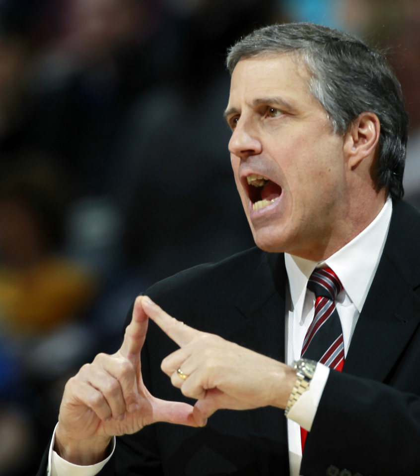 Photo - Washington Wizards head coach Randy Wittman ends in a play as the Wizards face the Denver Nuggets in the first quarter of an NBA basketball game in Denver on Sunday, March 23, 2014. (AP Photo/David Zalubowski)