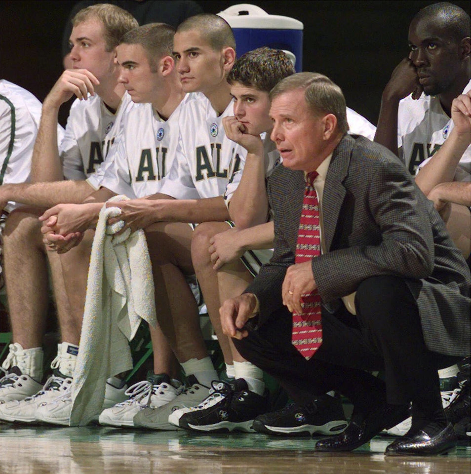 Photo - FILE--New Baylor head basketball coach Dave Bliss watches from the bench along with members of his team during a non-conference game on Nov. 25, 1999. Bliss will see his first Big 12 conference game against Texas this week. (AP Photo/Waco Tribune Herald, Rod Aydelotte, File)