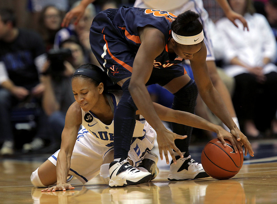 Photo - Duke's Chloe Wells, left, fights for the loose ball with Virginia's Raeshaun Gaffney during the second half of an NCAA women's college basketball game, Thursday, Jan. 16, 2014 in Durham, N.C. Duke won 90-55.  (AP Photo/Ted Richardson)
