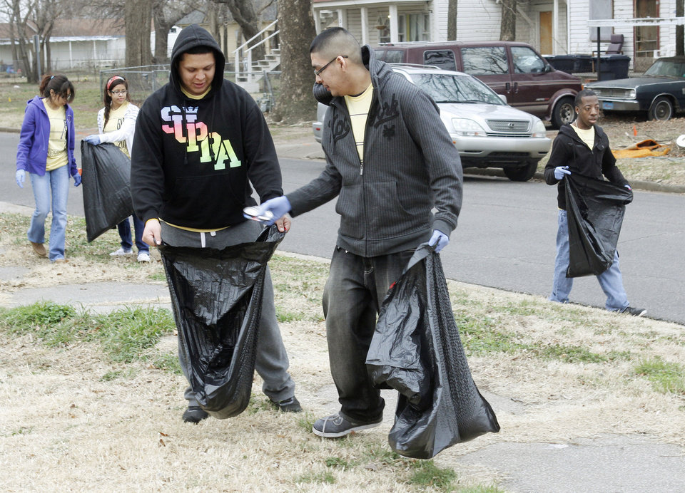 Victor Morales, left, and Jesse Becerra pick up trash during the UCO Big Event Day near SW 5 and Dewey in Oklahoma City.  By Paul Hellstern, The Oklahoman <strong>PAUL HELLSTERN - Oklahoman</strong>