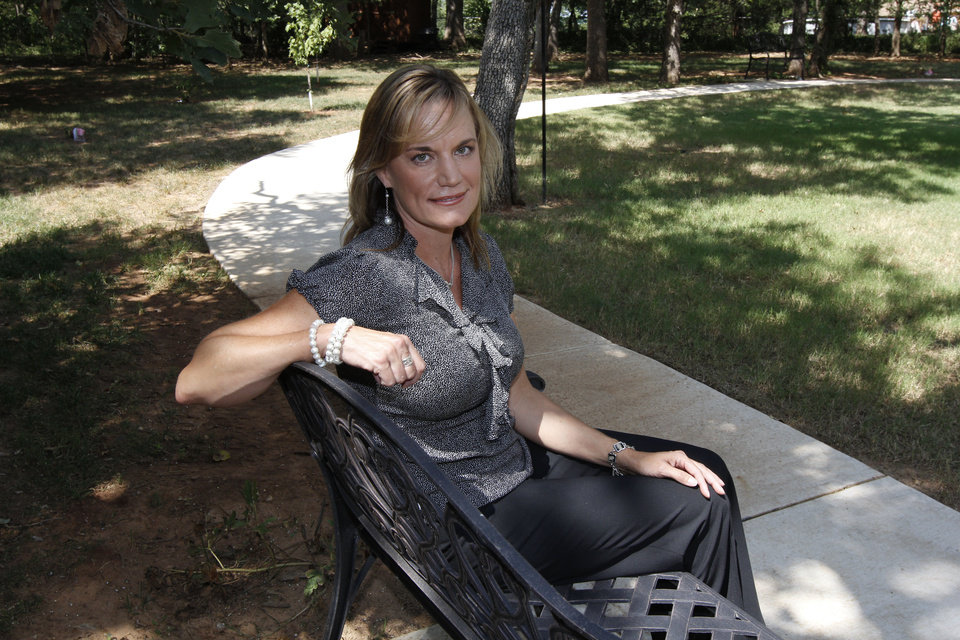 Photo - Shannon McClure is the owner of Eden Care, a non-traditional eldercare home in Logan County and Oklahoma City. She sits in the backyard of the home a mile north of Edmond. PHOTO BY PAUL HELLSTERN, THE OKLAHOMAN.  PAUL HELLSTERN - OKLAHOMAN