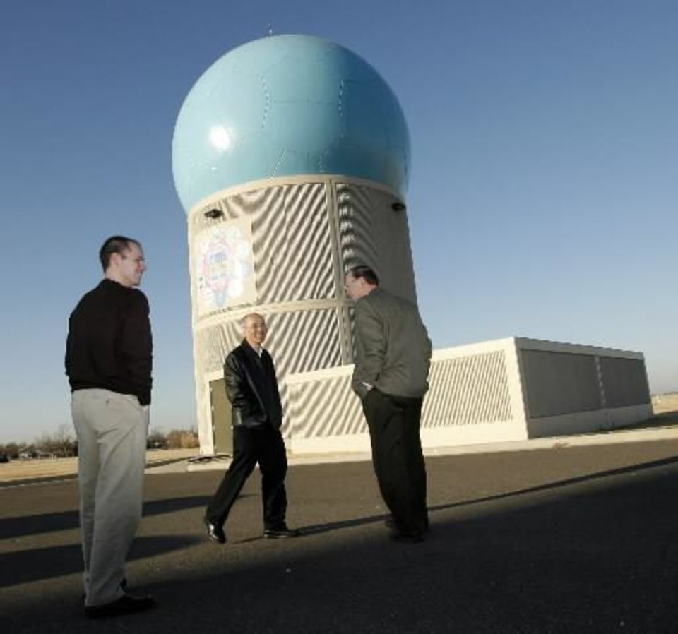 A group of scientists tour the  National  Severe  Storms  Laboratory phased array radar in  Norman, Oklahoma, on Thursday February 19, 2009. Photo by Steve Sisney