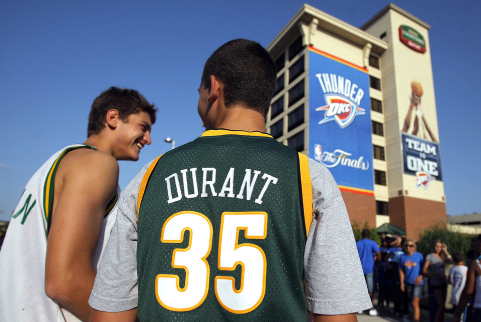 Peter Ernst, right, and Alec Ernst walk in Love's Thunder Alley during Game 2 of the NBA Finals on Thursday, June 14, 2012. <strong>SARAH PHIPPS - SARAH PHIPPS</strong>