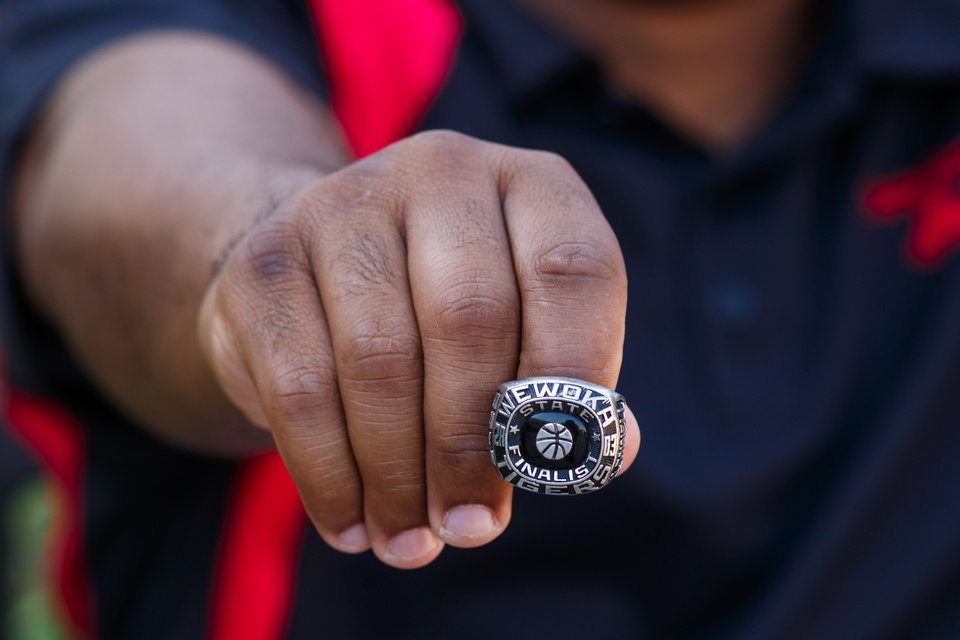 Photo -  Lonnell Alexander displays his ring's engravings at Remington Park in Oklahoma City. [Photo by Anya Magnuson, The Oklahoman]