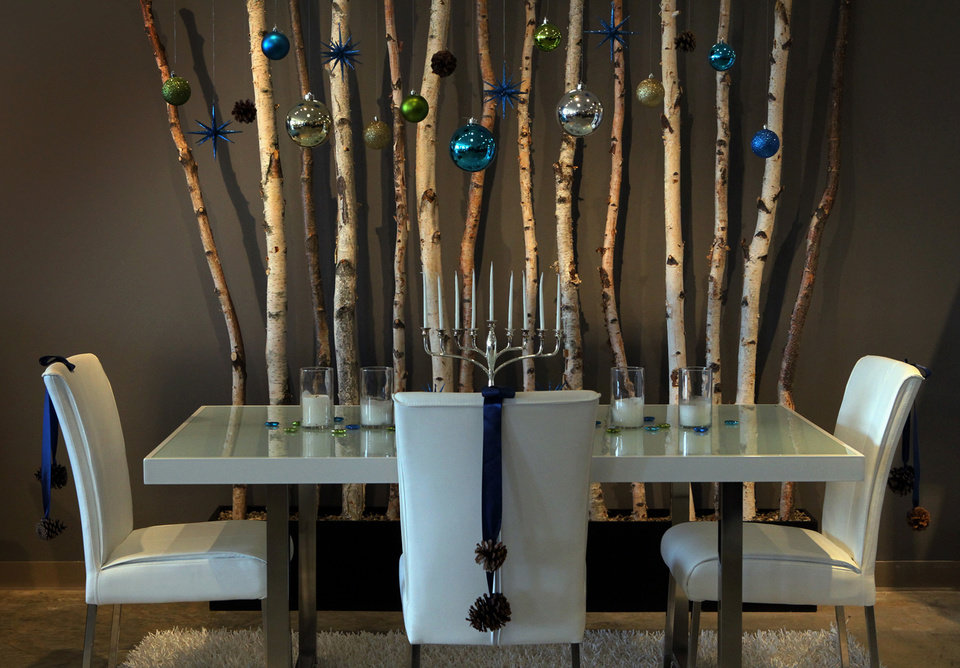 Photo - The designers at Ashley Furniture in Ballwin, Missouri set up several holiday decor scenes in their showroom on Manchester Road, November 13, 2012. The Hanukkah candles are the centerpiece of this dining room set up. (J.B. Forbes/St. Louis Post-Dispatch/MCT)