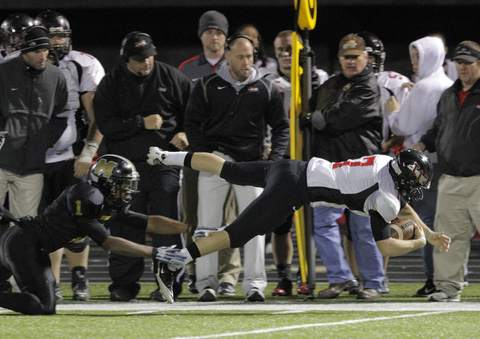 Photo - Westmoore's Trevor Thompson (7) dives in for a first down during a high school football game between Midwest City and Westmoore in Midwest City, Friday, Nov. 11, 2011.  Photo by Garett Fisbeck, for The Oklahoman