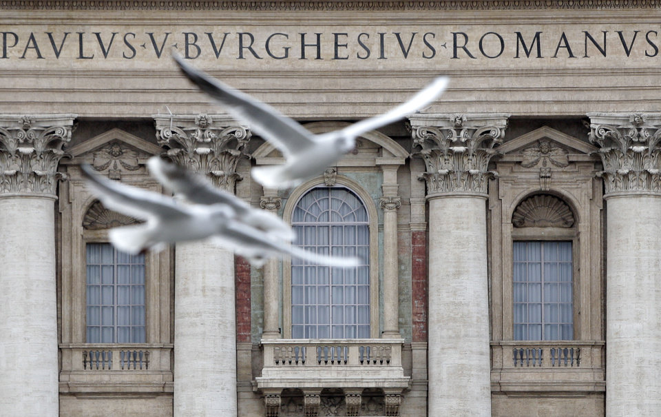 Seagulls fly in front of St. Peter's Basilca's central lodge, where newly elected popes make their first appearance, at The Vatican, Tuesday, Feb. 12, 2013.  With a few words in Latin, Pope Benedict XVI did what no pope has done in more than half a millennium, stunning the world by announcing his resignation Monday and leaving the already troubled Catholic Church to replace the leader of its 1 billion followers by Easter. (AP Photo/Riccardo De Luca)