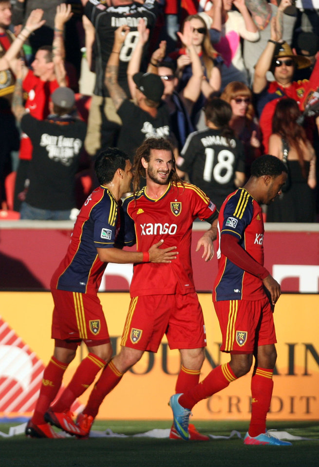 Photo - Real Salt Lake midfielder Kyle Beckerman, center, celebrates scoring the first goal of an MLS soccer game against Seattle FC with teammates Javier Morales, left,  and Robbie Findley at Rio Tinto Stadium in Sandy, Utah, on Saturday, June 22, 2013. (AP Photo/The Salt Lake Tribune, Kim Raff)  DESERET NEWS OUT; LOCAL TV OUT; MAGS OUT.