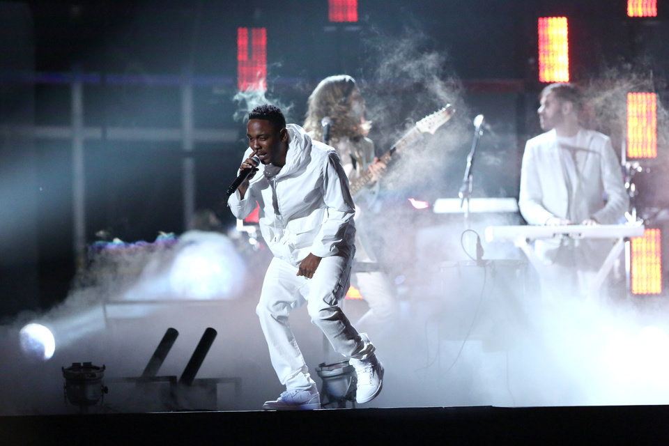 Photo - Kendrick Lamar performs  at the 56th annual Grammy Awards at Staples Center on Sunday, Jan. 26, 2014, in Los Angeles. (Photo by Matt Sayles/Invision/AP)