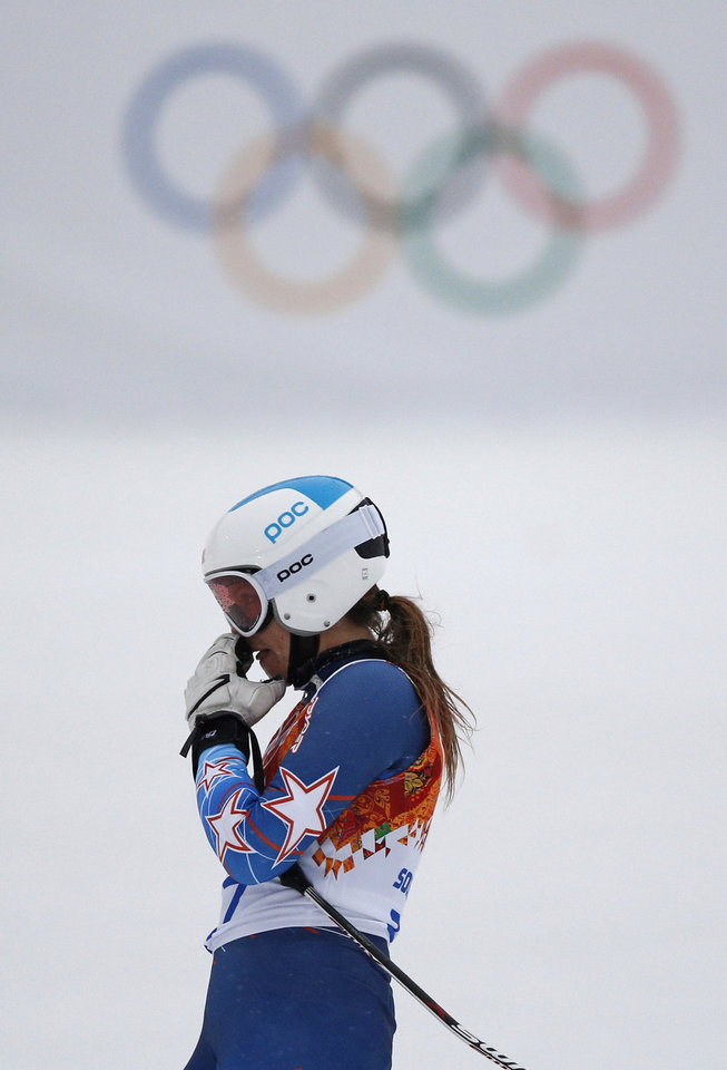 Photo - United States' Julia Mancuso reacts after skiing out of the first run of the women's giant slalom at the Sochi 2014 Winter Olympics, Tuesday, Feb. 18, 2014 in Krasnaya Polyana, Russia.(AP Photo/Christophe Ena)