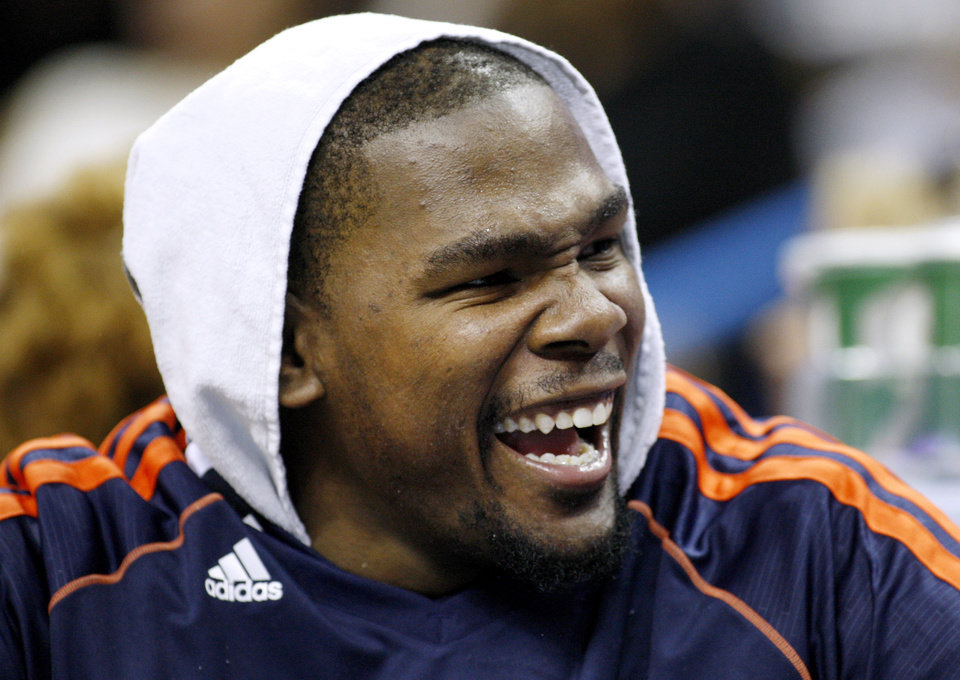 Oklahoma City\'s Kevin Durant (35) smiles on the bench during the second half of an NBA basketball game against the New Orleans Hornets in New Orleans, Friday, Nov. 16, 2012. The Thunder won 110-95. (AP Photo/Jonathan Bachman) ORG XMIT: LAJB114