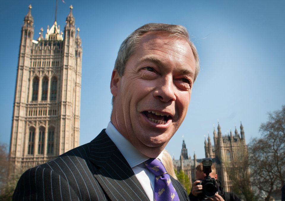 Photo - United Kingdom Independence Party (UKIP) leader Nigel Farage arrives in Westminster, London, Friday May 3, 2013, after a successful night in the local council elections. David Cameron's Conservative Party has taken a drubbing in local elections amid a surge of support for right-wing UKIP, an anti-European Union and anti-immigration party. The rise of UKIP adds to pressure on Cameron to staunch a flow of voters from his party ahead of the next general election in 2015 and take a harder line on European reform. (AP Photo/PA, Stefan Rousseau) UNITED KINGDOM OUT  NO SALES  NO ARCHIVE