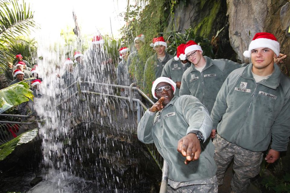 New recruits pose for a photo by the waterfall in the Crystal Bridge at the Myriad Gardens during Soldiers Day Out, Friday, December 21, 2012. Edmond/North OKC Blue Star Mothers will be taking the soldiers who can't go home for Christmas around the metro for a day of fun. Photo By David McDaniel/The Oklahoman