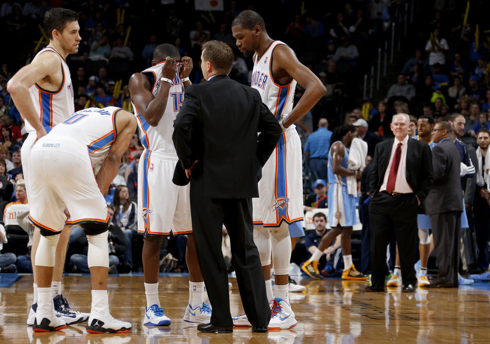 Oklahoma City coach Scott Brooks talks tim Oklahoma City\'s Russell Westbrook (0), Nick Collison (4), Reggie Jackson (15), and Kevin Durant (35) during an NBA basketball game between the Oklahoma City Thunder and the Denver Nuggets at Chesapeake Energy Arena in Oklahoma City, Tuesday, March 19, 2013. Denver won 114-104. Photo by Bryan Terry, The Oklahoman