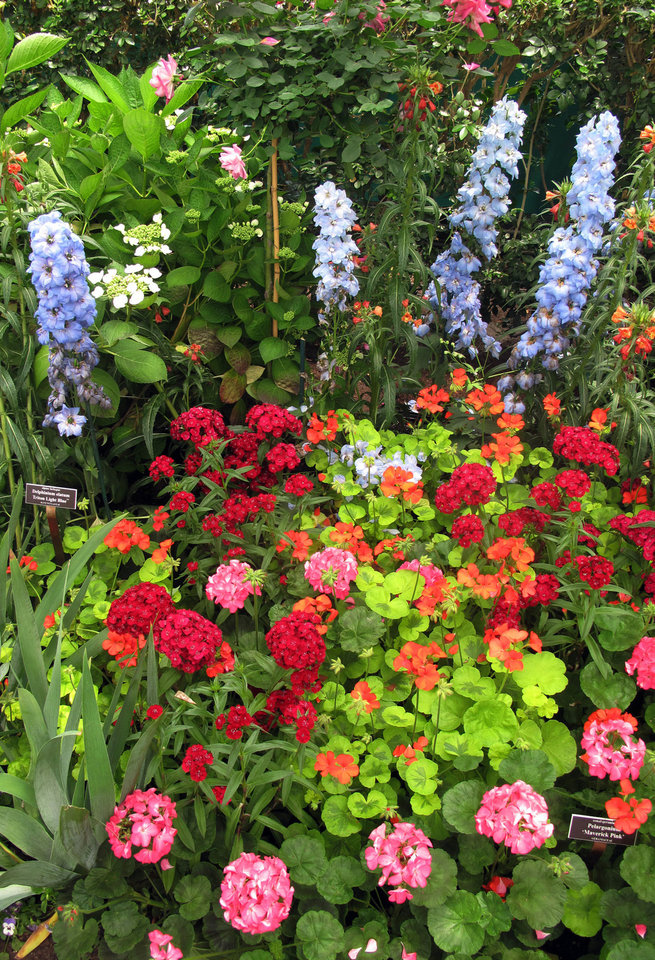 Photo - In this May 26, 2012 photo, a display of flowers is seen in