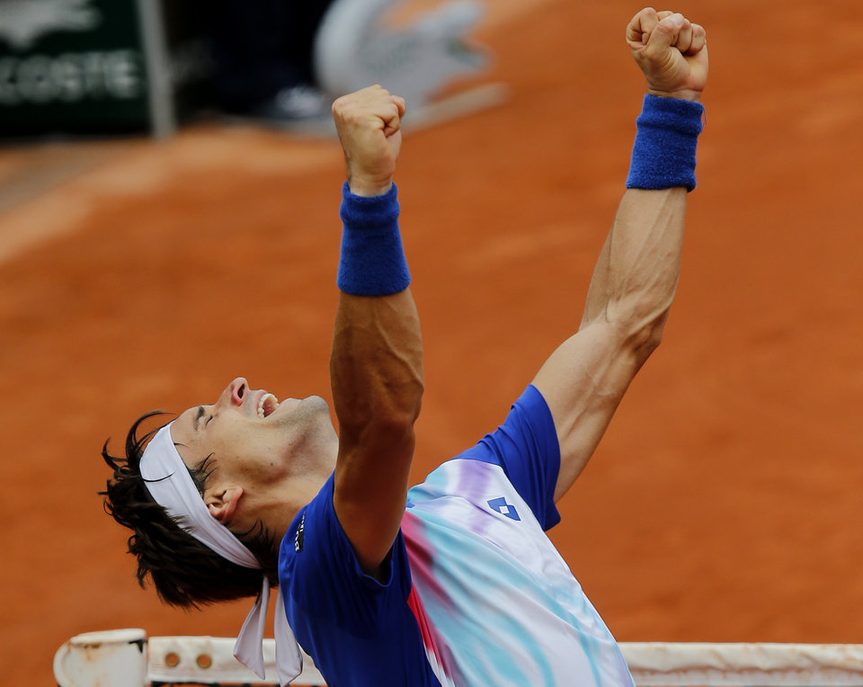 Photo - Spain's David Ferrer reacts after defeating South Africa's Kevin Anderson during their fourth round match of  the French Open tennis tournament at the Roland Garros stadium, in Paris, France, Monday, June 2, 2014. Ferrer won 6-3, 6-3, 6-7, 6-1. (AP Photo/David Vincent)