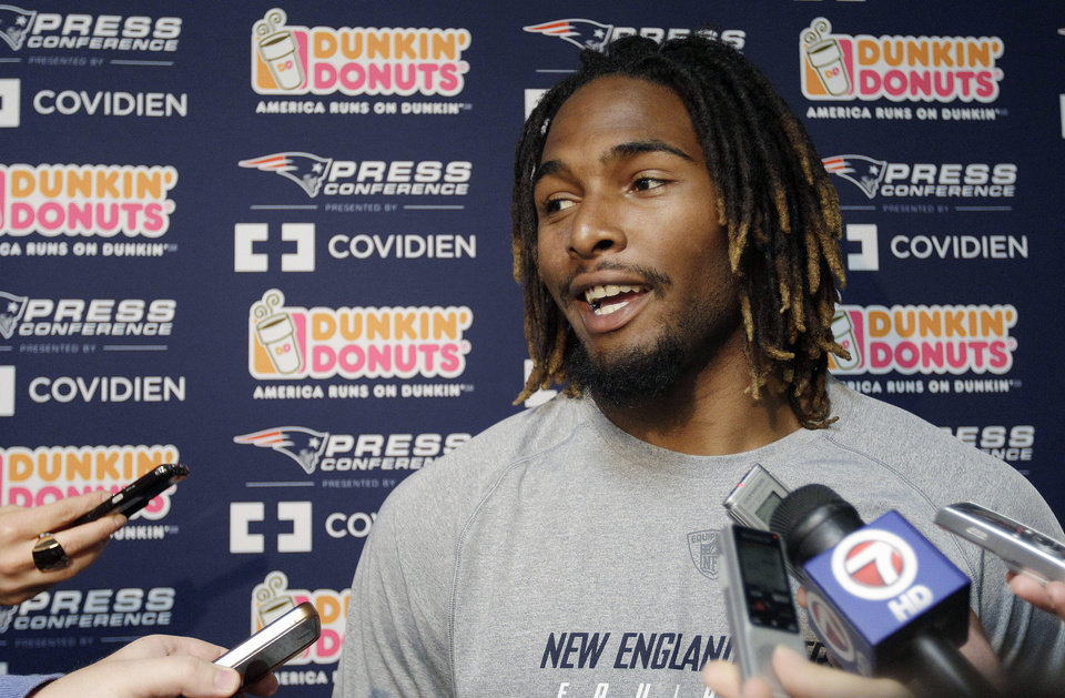 Photo -   New England Patriots rookie running back Brandon Bolden, out of Mississippi, talks to reporters during a media availability at the NFL football team's facility in Foxborough, Mass., Friday, May 11, 2012. (AP Photo/Stephan Savoia)