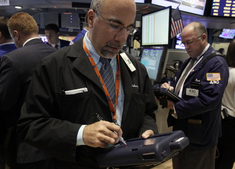 Photo -   Trader John Liotti, left, works on the floor of the New York Stock Exchange Wednesday, Oct. 3, 2012. Stocks are mostly higher in early trading on Wall Street Wednesday after a measure of private sector hiring came in better than economists were expecting. (AP Photo/Richard Drew)