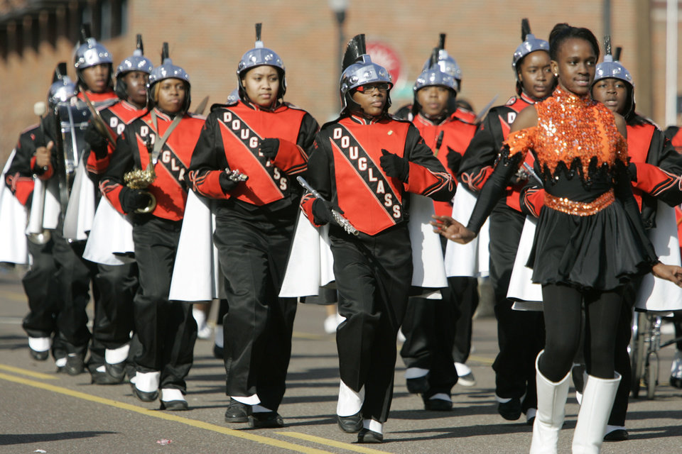 Photo - The Douglass High School Marching Band preforms in the Martin Luther King Jr. Day Parade in Oklahoma City, Oklahoma January 18, 2010. Photo by Steve Gooch, The Oklahoman