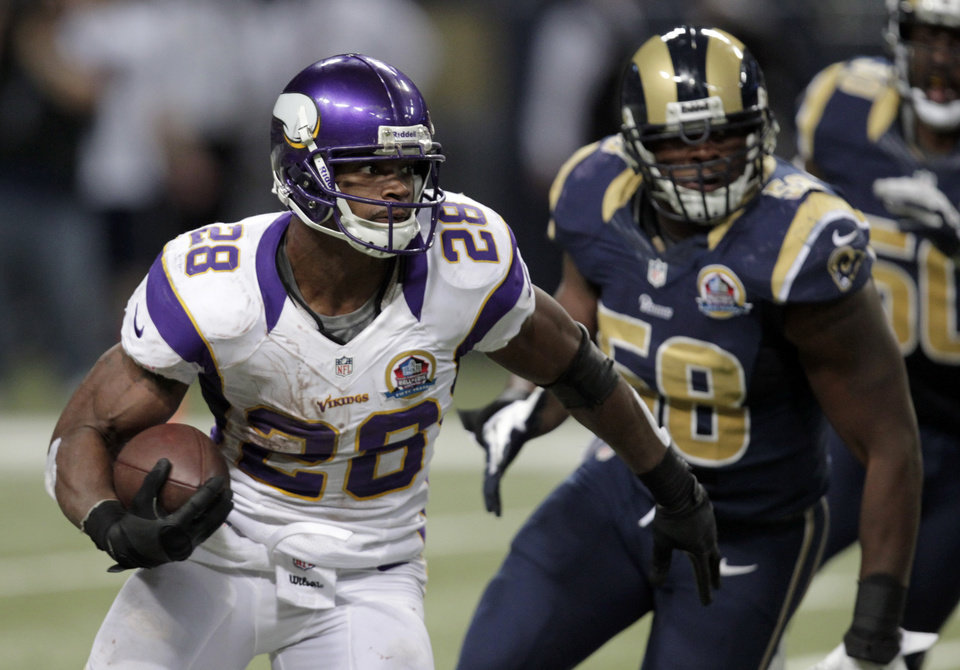 Minnesota Vikings running back Adrian Peterson, left, runs past St. Louis Rams outside linebacker Jo-Lonn Dunbar on his way to a 52-yard gain during the fourth quarter of an NFL football game Sunday, Dec. 16, 2012, in St. Louis. (AP Photo/Tom Gannam)