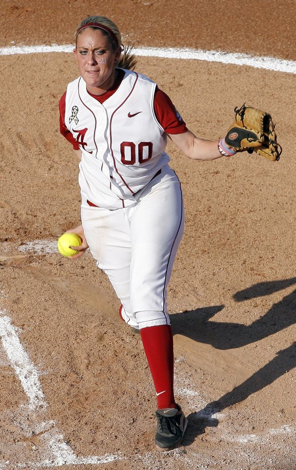 Photo - Alabama's Kelsi Dunne (00) pitches during the Women's College World Series game between Floridia and Alabama at the ASA Hall of Fame Stadium in Oklahoma City, Sunday, June 5, 2011. Photo by Garett Fisbeck, The Oklahoman