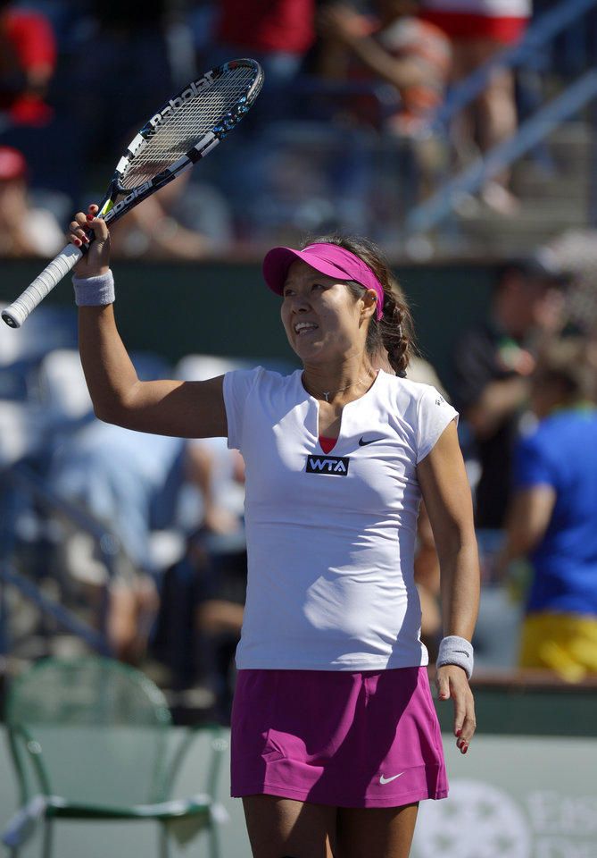 Photo - Li Na, of China, celebrates after defeating Zheng Jie, of China, 6-1, 7-5 in their match at the BNP Paribas Open tennis tournament, Saturday, March 8, 2014, in Indian Wells, Calif. (AP Photo/Mark J. Terrill)