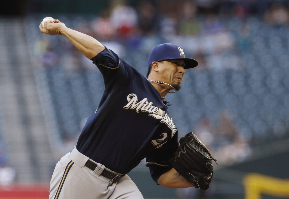Photo - Milwaukee Brewers' Kyle Lohse throws a pitch against the Arizona Diamondbacks during the first inning of a baseball game on Tuesday, June 17, 2014, in Phoenix. (AP Photo/Ross D. Franklin)