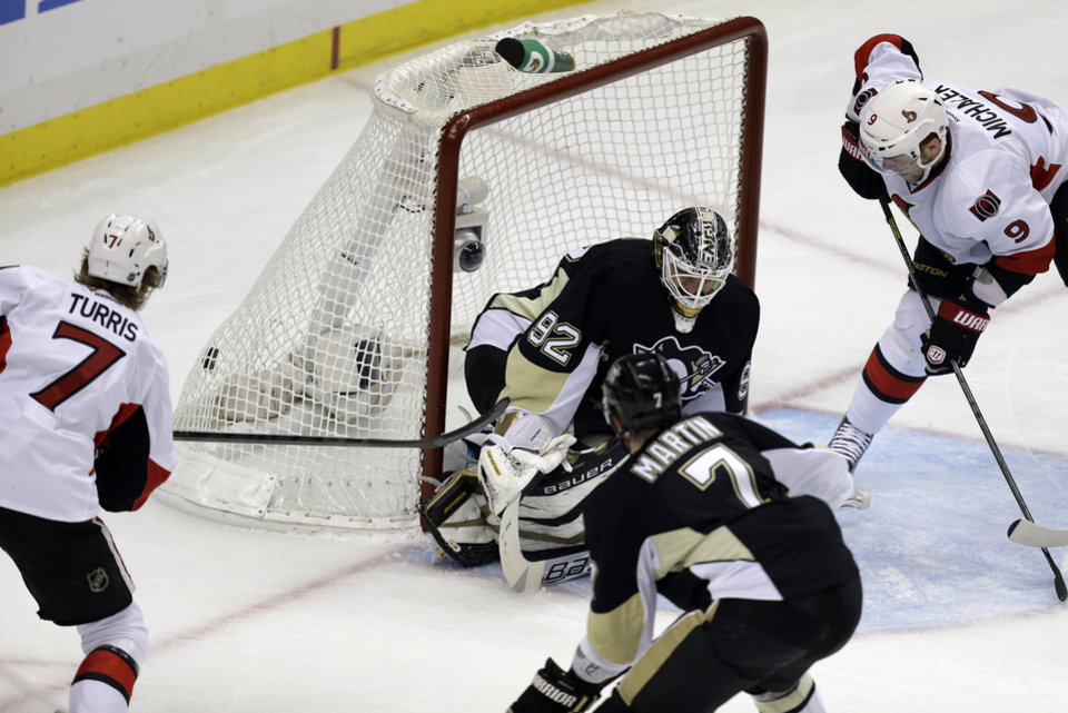 Photo - Ottawa Senators' Kyle Turris (7) scores past Pittsburgh Penguins goalie Tomas Vokoun (92) during the first period of Game 2 of an NHL hockey Stanley Cup second-round playoff series, in Pittsburgh on Friday, May 17, 2013. (AP Photo/Gene J. Puskar)