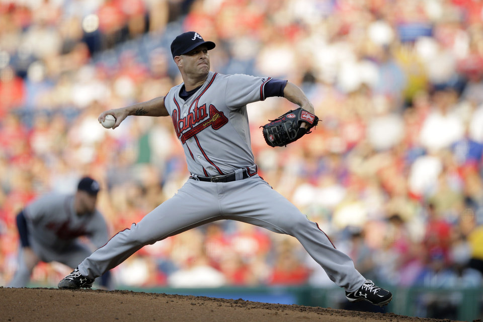 Atlanta Braves' Tim Hudson pitches in the first inning of a baseball game against the Philadelphia Phillies, Friday, July 6, 2012, in Philadelphia. (AP Photo/Matt Slocum)