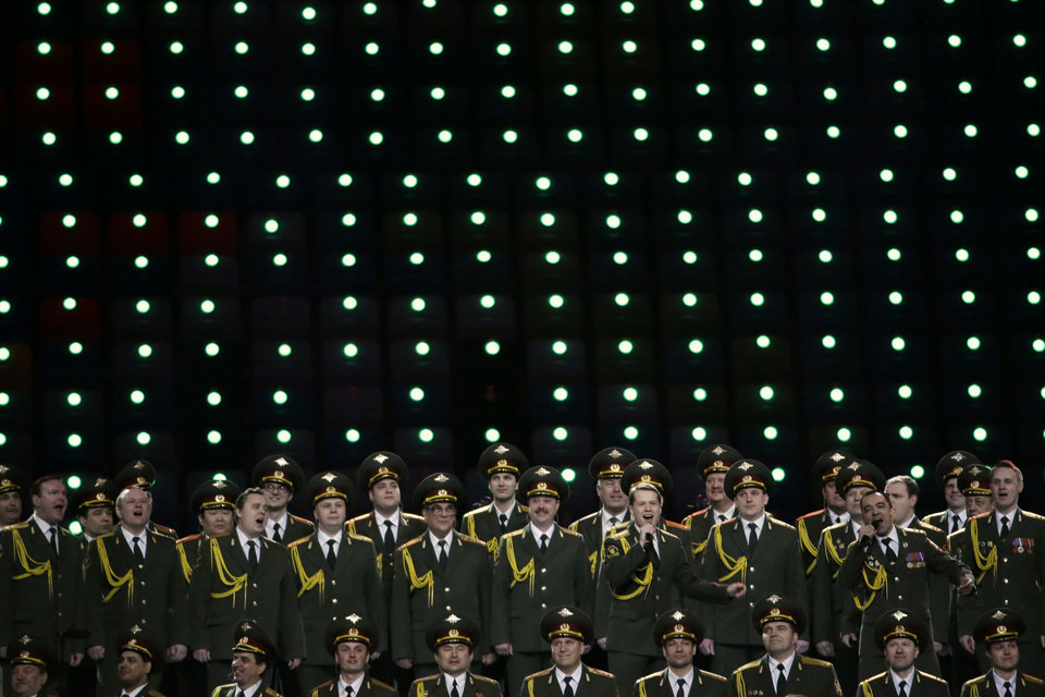 Photo - The Russian Interior Ministry choir perform prior to the opening ceremony of the 2014 Winter Olympics in Sochi, Russia, Friday, Feb. 7, 2014. (AP Photo/Mark Humphrey)