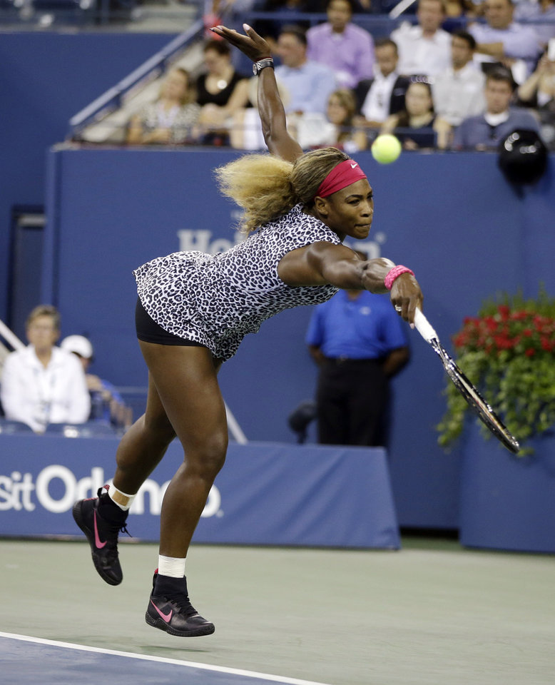 Photo - Serena Williams, of the United States, reaches to return a shot to Flavia Pennetta, of Italy, during the quarterfinals of the U.S. Open tennis tournament Wednesday, Sept. 3, 2014, in New York. (AP Photo/Darron Cummings)