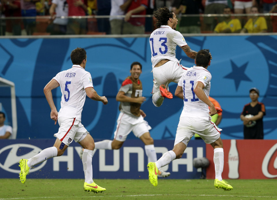 Photo - United States' Jermaine Jones (13) celebrates after scoring his side's first goal during the group G World Cup soccer match between the United States and Portugal at the Arena da Amazonia in Manaus, Brazil, Sunday, June 22, 2014. (AP Photo/Martin Mejia)