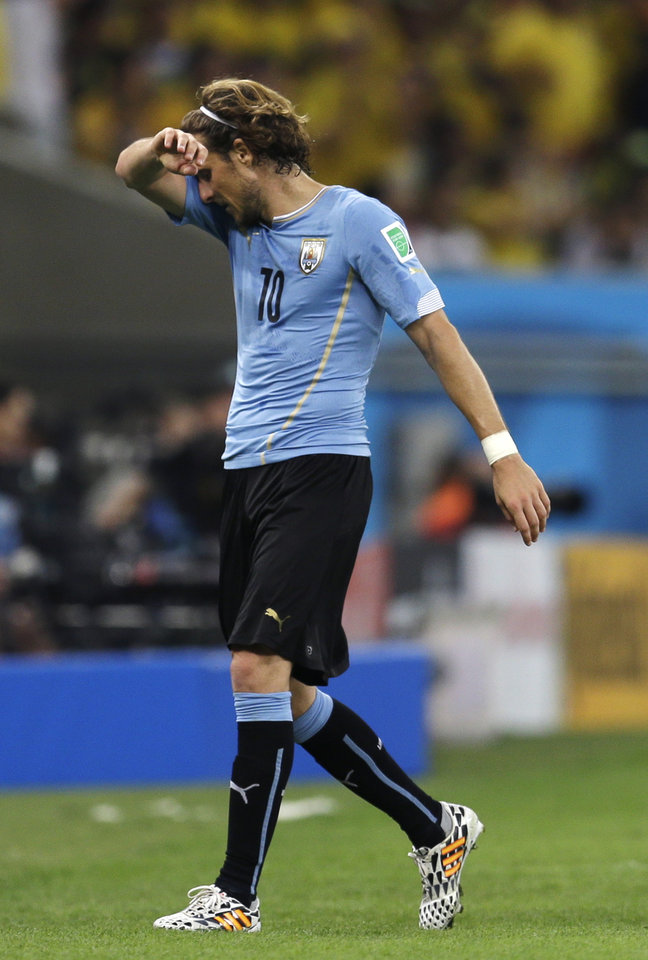 Photo - Uruguay's Diego Forlan leaves the field during the World Cup round of 16 soccer match between Colombia and Uruguay at the Maracana Stadium in Rio de Janeiro, Brazil, Saturday, June 28, 2014. (AP Photo/Natacha Pisarenko)