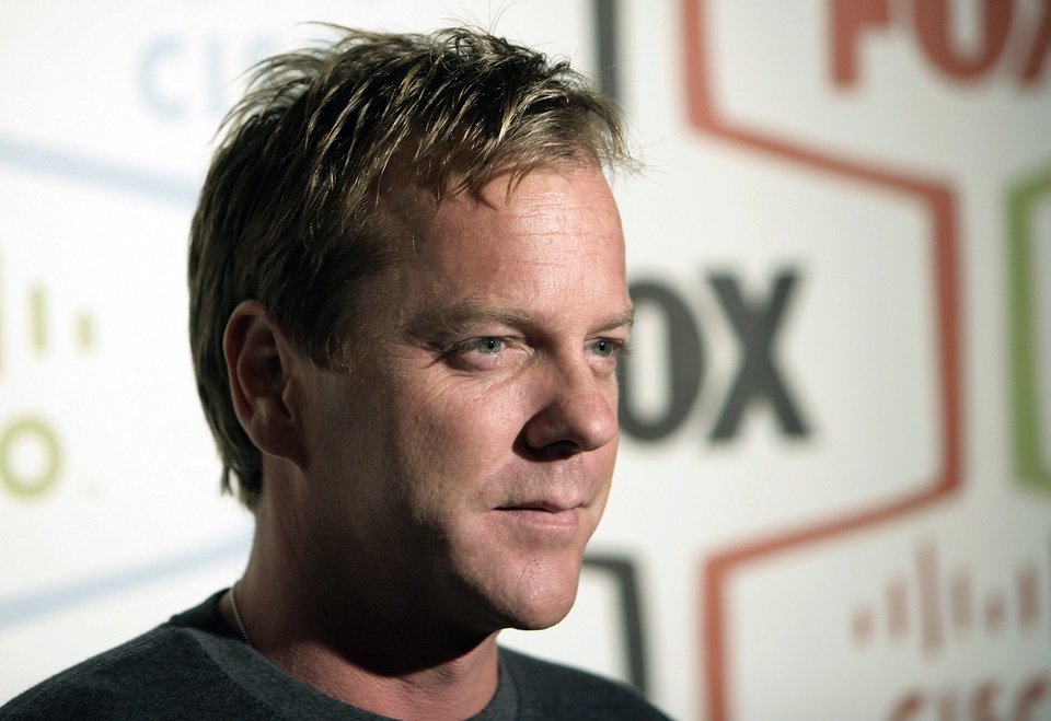 Photo - FILE - In this Monday, Sept. 24, 2007 file photo, actor Kiefer Sutherland arrives at the Fox Fall Eco-Casino party in Los Angeles. Fox, facing the ebbing ratings power of