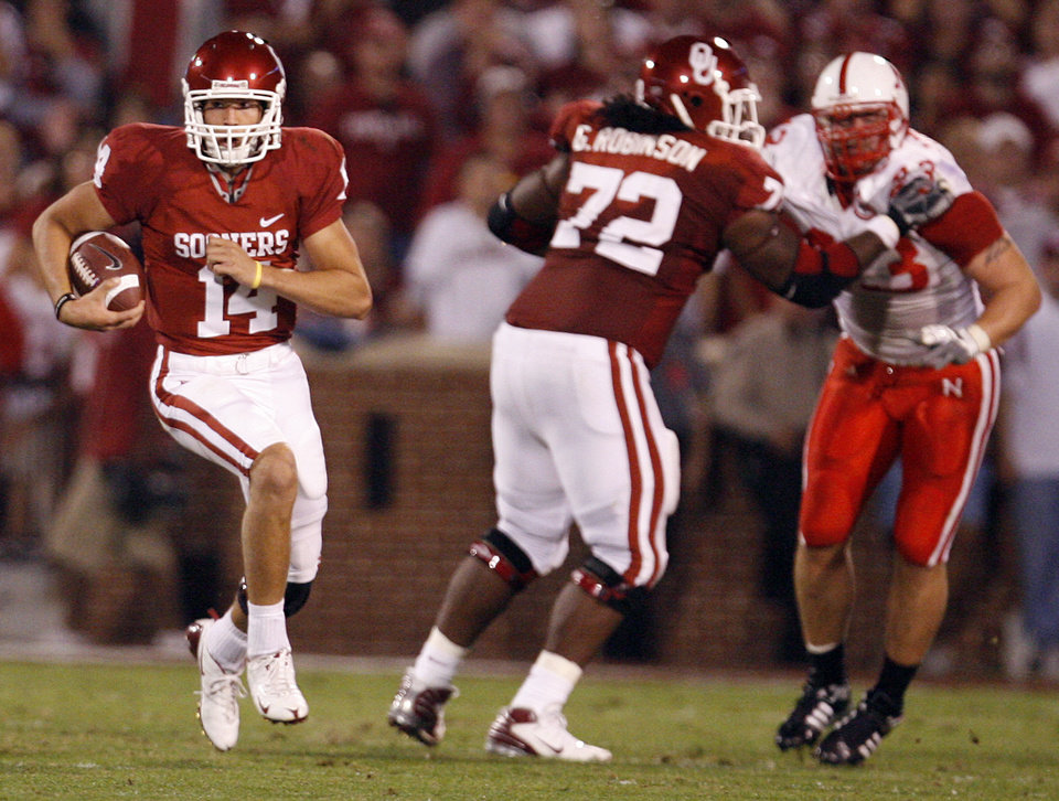 Quarterback Sam Bradford (14) looks for running room against Nebraska during the first half of the college football game between the University of Oklahoma Sooners (OU) and the University of Nebraska Huskers (NU) at the Gaylord Family-Oklahoma Memorial Stadium, on Saturday, Nov. 1, 2008, in Norman, Okla. 