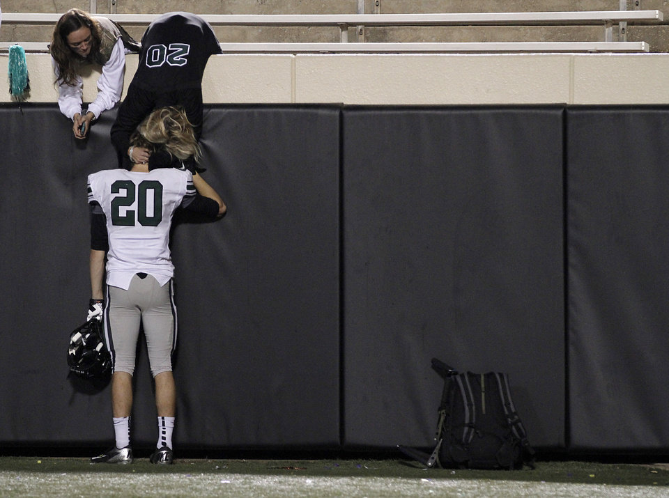 Norman North's Corbin Cleveland is consoled as he leaves the field after the loss to Jenks during the Class 6A Oklahoma state championship football game between Norman North High School and Jenks High School at Boone Pickens Stadium on Friday, Nov. 30, 2012, in Stillwater, Okla.   Photo by Chris Landsberger, The Oklahoman