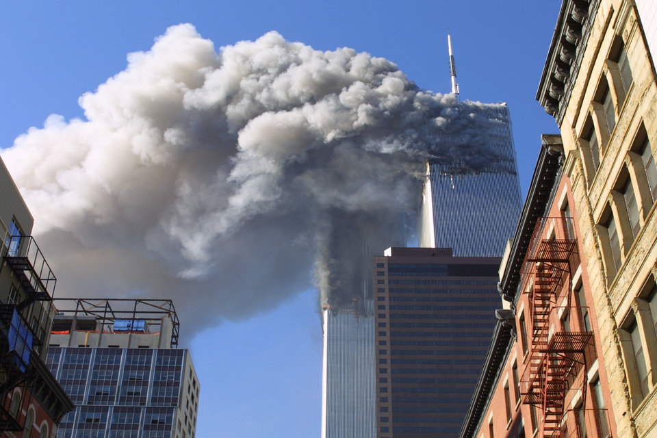 Photo - FILE - In this Sept. 11, 2001 file photo, the twin towers of the World Trade Center burn after hijacked planes crashed into them in New York. A person familiar with developments said Sunday, May 1, 2011 that Osama bin Laden is dead and the U.S. has the body. (AP Photo/Diane Bondareff, File) ORG XMIT: NY212
