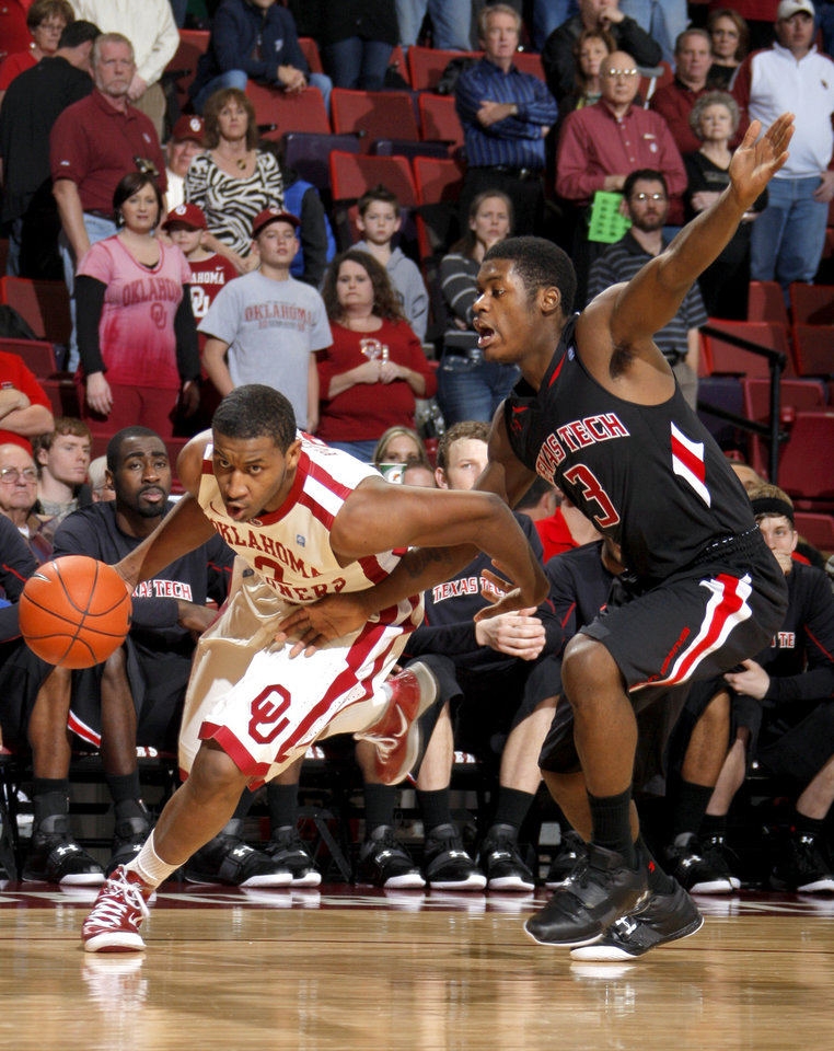Photo - Oklahoma's Steven Pledger (2) drives to the basket as Texas Tech's DeShon Minnis (3) defends during the men's college basketball game between the University of Oklahoma  and Texas Tech University of at the Lloyd Nobel Center in Norman, Okla., Tuesday, Jan. 17, 2012. Photo by Sarah Phipps, The Oklahoman