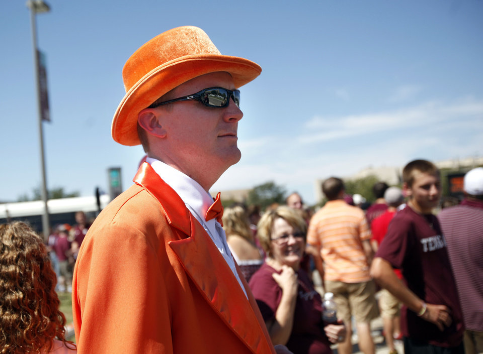 Oklahoma State Fan Philip Parr waits to cross the street before the Cowboys took on Texas A&M on Saturday in College Station, Texas. Photo by Sarah Phipps, The Oklahoman