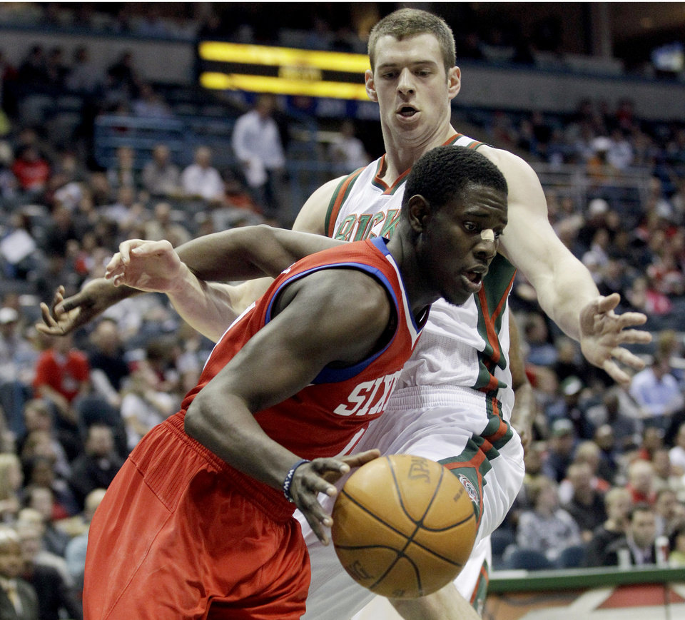Philadelphia 76ers' Jrue Holiday drives past Milwaukee Bucks' Jon Leuer during the first half of an NBA basketball game, Wednesday, April 25, 2012, in Milwaukee. (AP Photo/Morry Gash)