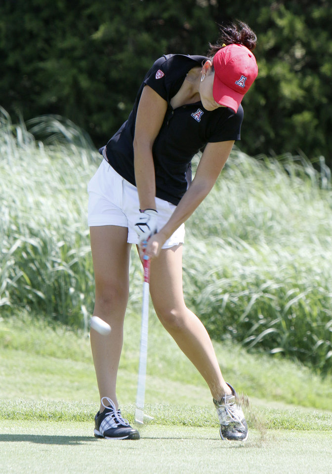 Photo - Shelby Martinek hits from the fairway during the match play semifinals of the WSGA championship at Gaillardia Country Club in Oklahoma City, OK, Thursday, June 5, 2014,  Photo by Paul Hellstern, The Oklahoman