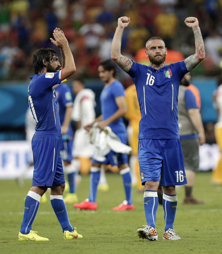 Photo - Italy's Andrea Pirlo, left, and Italy's Daniele De Rossi (16) celebrate after their 2-1 victory over England during their group D World Cup soccer match at the Arena da Amazonia in Manaus, Brazil, Saturday, June 14, 2014.