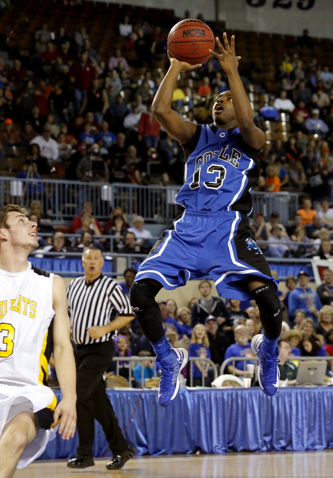 Coyle's Eric Harris goes to the basket past  Arnett's Trevor Bryant during the Class B boys state championship game between Coyle and Arnett in the State Fair Arena at State Fair Park in Oklahoma City, Saturday, March 2, 2013. Photo by Bryan Terry, The Oklahoman