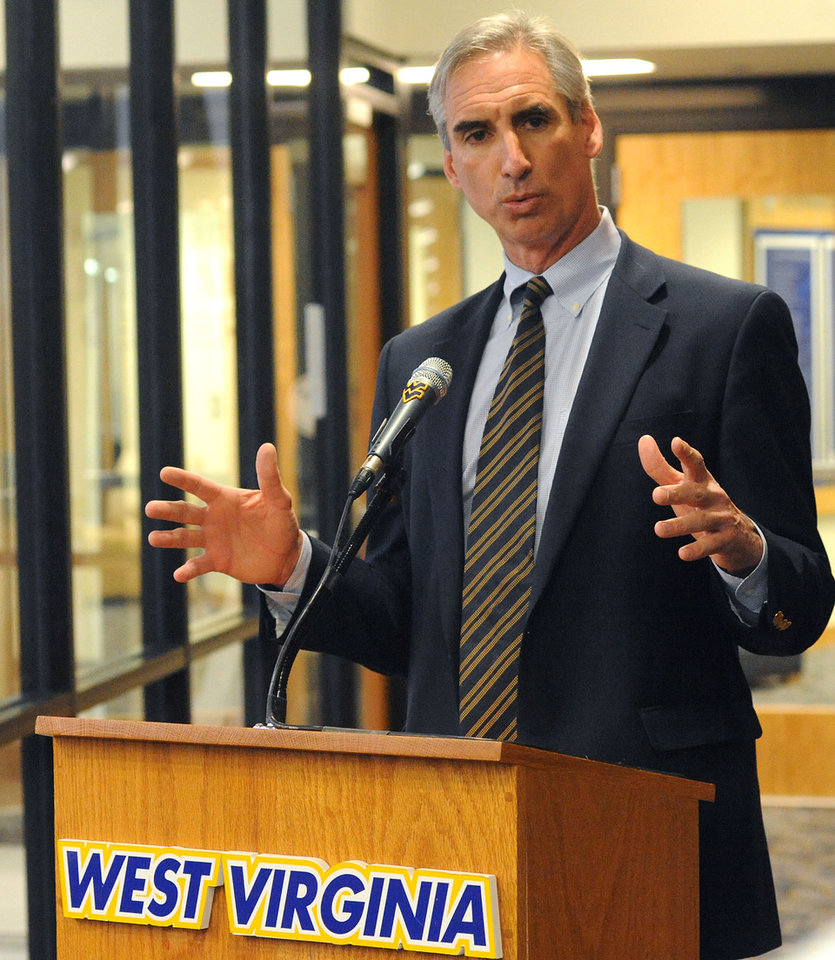 West Virginia University athletic director Oliver Luck speaks addresses the media during a news conference ,Thursday, Dec. 16, 2010, outside of his office at the WVU Coliseum in Morgantown, W.Va. Luck spoke about the hiring of Oklahoma State offensive coordinator Dana Holgorsen as the school's head coach in waiting. Holgorsen will serve as the Mountaineers offensive coordinator for the 2011 season and then replace current head coach Bill Stewart in 2012. (AP Photo/The Dominion Post, Jason DeProspero)