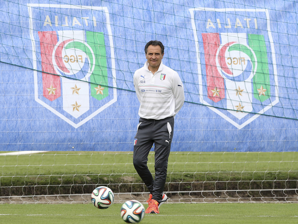 Photo - Italy coach Cesare Prandelli watches his players during a training session of Italy in Mangaratiba, Brazil, Saturday, June 7, 2014. Italy play in group D of the 2014 soccer World Cup. (AP Photo/Antonio Calanni)