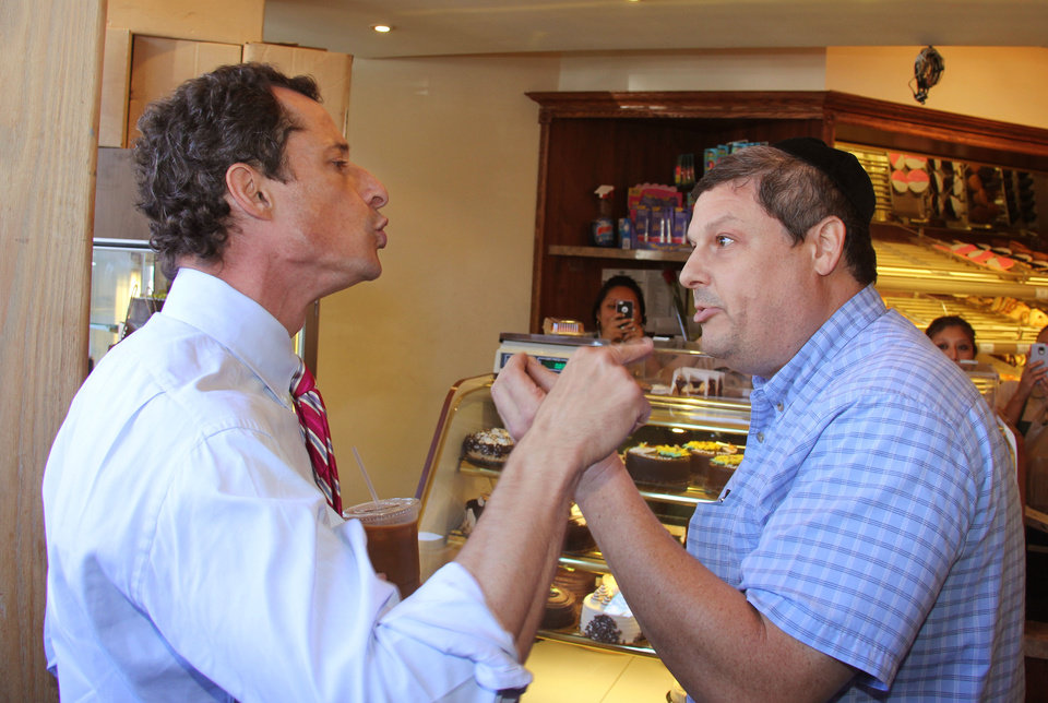 Anthony Weiner, left, who is seeking the Democratic nomination to run for the New York City Mayor's Office, has a heated argument with Shaul Kessler at Weiss Bakery in the Boro Park neighborhood in the Brooklyn borough of New York, Wednesday, Sept. 4, 2013. The altercation was captured on video and is circulating widely over the Internet. Weiner's support as a Democratic candidate for mayor collapsed amid a new sexting scandal in June, 2013 and is currently polling fourth among the candidates at 7 percent. (AP Photo/Shimon Gifter)