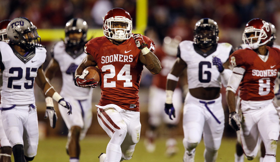 Photo - Oklahoma's Brennan Clay (24) runs on a fourth quarter touchdown in the college football game between the University of Oklahoma Sooners (OU) and the TCU Horned Frogs at Gaylord Family-Oklahoma Memorial Stadium in Norman, Okla., on Saturday, Oct. 5, 2013. Photo by Steve Sisney, The Oklahoman