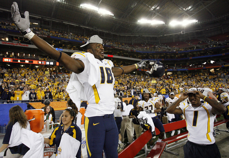 Photo - West Virginia's Darren Brownlee (18) celebrates after the 48-28 win over the Sooners in the Fiesta Bowl college football game between the University of Oklahoma Sooners (OU) and the West Virginia University Mountaineers (WVU) at The University of Phoenix Stadium on Wednesday, Jan. 2, 2008, in Glendale, Ariz. 