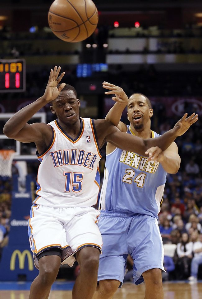 Oklahoma City's Reggie Jackson (15) battles with Denver's Andre Miller (24) during the NBA basketball game between the Oklahoma City Thunder and the Denver Nuggets at the Chesapeake Energy Arena on Wednesday, Jan. 16, 2013, in Oklahoma City, Okla.  Photo by Chris Landsberger, The Oklahoman
